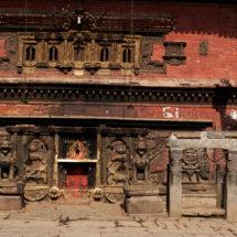 Lady walking in front of temple Kathmandu